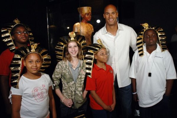 "Miami Dolphins star Jason Taylor, second from right, poses with winners of a King Tut trivia contest from left, Lians Jean List, Taylor Brown, Judith Betancourt, Keytorri Partlow, and Stephen Pitts, far right next to a bust of Tutankhamun inside one of the galleries of the ""Tutankhamun and the Golden Age of the Pharaohs"" museum exhibition at the Museum of Art/Fort Lauderdale Wednesday April 5, 2006 in Fort Lauderdale, Fla.  Taylor surprised South Florida elementary through eighth grade students at the ""Tutankhamun and the Golden Age of the Pharaohs"" museum exhibition at the Museum of Art/Fort Lauderdale.  The Jason Taylor Foundation donated tickets to nearly 250 students from Mays Middle School, Sunland Park Elementary School and the Urban League of Miami-Dade to tour the exhibit, now in its final weeks.   The MoA/FL exhibition, second of four venues during its 27-month tour of the US and the only southeast destination, is organized by National Geographic, AEG Exhibitions, and Arts and Exhibitions International, with cooperation from the Egyptian Supreme Council of Antiquities, and locally sponsored by Blue Cross and Blue Shield of Florida.   (AP PHOTO/MUSEUM OF ART/FORT LAUDERDALE, David Adame)"