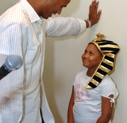 "Miami Dolphins star Jason Taylor, left, chats with a starstruck Taylor Brown, right, one of the winners of a King Tut trivia contest at the ""Tutankhamun and the Golden Age of the Pharaohs"" museum exhibition at the Museum of Art/Fort Lauderdale Wednesday April 5, 2006 in Fort Lauderdale, Fla.  Taylor surprised South Florida elementary through eighth grade students at the ""Tutankhamun and the Golden Age of the Pharaohs"" museum exhibition at the Museum of Art/Fort Lauderdale.  The Jason Taylor Foundation donated tickets to nearly 250 students from Mays Middle School, Sunland Park Elementary School and the Urban League of Miami-Dade to tour the exhibit, now in its final weeks.   The MoA/FL exhibition, second of four venues during its 27-month tour of the US and the only southeast destination, is organized by National Geographic, AEG Exhibitions, and Arts and Exhibitions International, with cooperation from the Egyptian Supreme Council of Antiquities, and locally sponsored by Blue Cross and Blue Shield of Florida.   (AP PHOTO/MUSEUM OF ART/FORT LAUDERDALE, David Adame)"