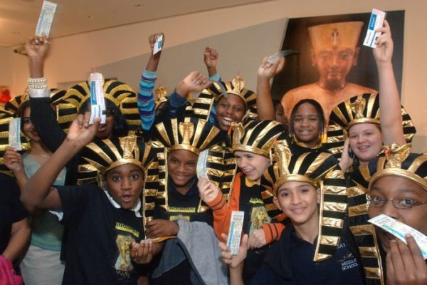 "Students from the Downtown Academy of Technology and Arts wave their free tickets for the exhibition ""Tutankhamun and the Golden Age of the Pharaohs"" Tuesday Oct. 18, 2005 at the Museum of Art/Fort Lauderdale in Fort Lauderdale, Fla.   Northern Trust, one of the world's largest private banking firms, is the exhibition's US sponsor and donated the tickets to the children.  Ticket sales begin today.   The touring exhibition, organized by National Geographic, AEG Exhibitions and Arts and Exhibitions International, with cooperation from the Egyptian Supreme Council of Antiquities, will open at the museum of Art/Fort Lauderdale on Dec. 15, 2005.  The exhibit kicked off it's US tour in Los Angeles on June 16, 2005, marking the first time the treasures of King Tut  visited America in 26 years.   (AP PHOTO/MoA/FL, David Adame)"