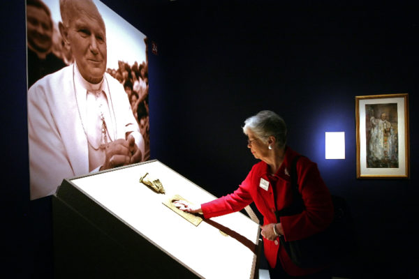 Joan Tinsky places her hand into a cast of the hand of Pope John Paul II during a special media preview of Vatican Splendors: A Journey through Faith and Art Thursday Jan 27, 2011 at the Museum of Art/Fort Lauderdale in Fort Lauderdale.  Museum of Art | Fort Lauderdale will host Vatican Splendors: A Journey through Faith and Art beginning January 29. ÊThe exhibition features nearly 200 rare works of art and historically significant objects, many of which have never left the Vatican.   Fort Lauderdale is one of only three U.S. cities to host Vatican Splendors.  (Museum of Art/Fort Lauderdale, David Adame)